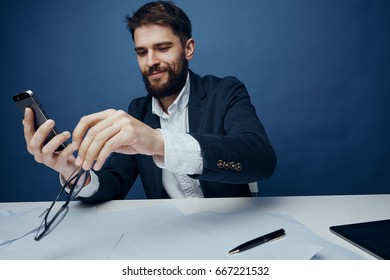 Business man working on a blue background