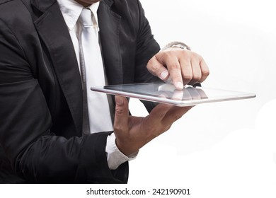 business man working on computer tablet touching screen with white copy space use for technology and internet communiacation activities