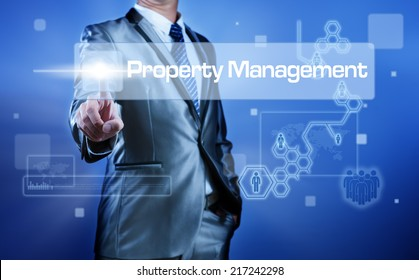 Business man working on digital virtual screen press on button property management