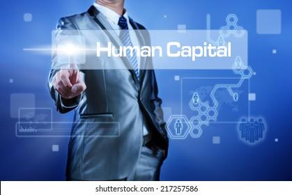 Business man working on digital virtual screen press on button human capital