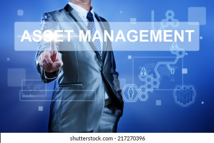 Business man working on digital virtual screen press on button asset management