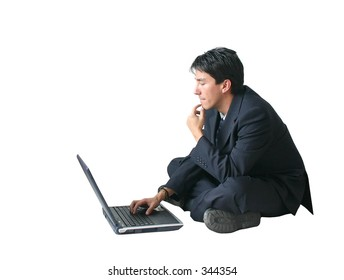 business man working on a laptop on the floor