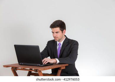 Business man is working on a laptop