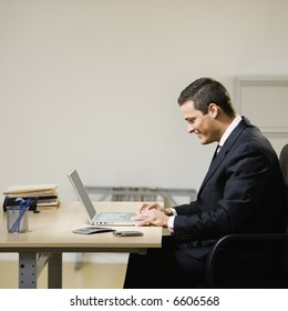 Business man working on laptop at desk