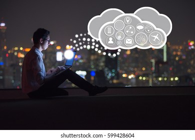 Business man working on rooftop connection with cloud technology and commnication icon