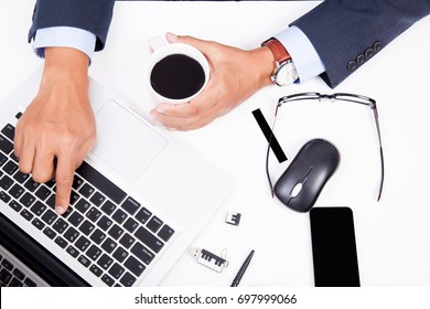 Business man working on white table with notebook in office.