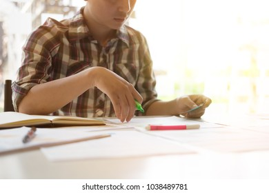 Business man working on workplace with pen maker on hand highlight a word on paper.