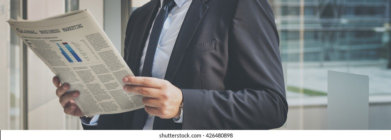 Business Man Working Reading Newspaper Concept