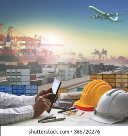 business man working table in container dock use for logistic industry and import export , freight cargo shipping theme
