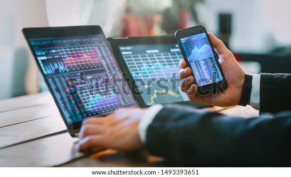 Business man working with trader graphics concept.