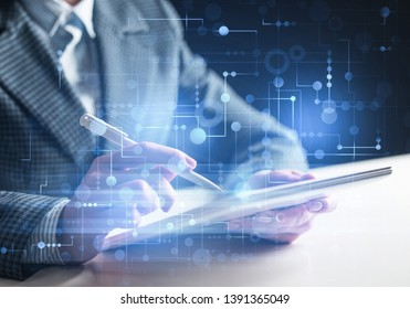 Business man works in office with tablet computer. Virtual geometric graphics. Futuristic interface with glowing digital hologram. Double exposure concept of internet network. Cybernetic workspace