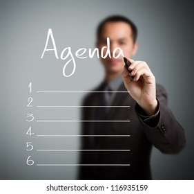 business man writing blank agenda list