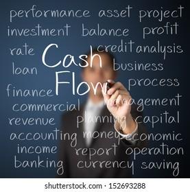 business man writing cash flow concept