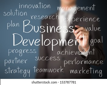 business man writing business development concept