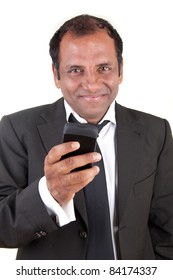 Business man writing message with his mobile phone