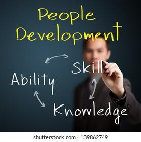 business man writing people development concept