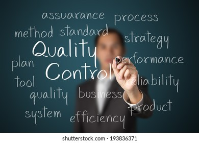 business man writing quality control concept