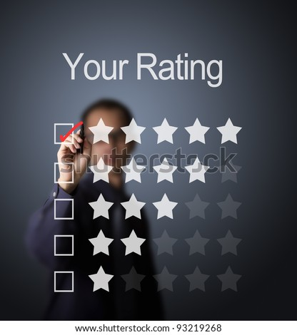 business man writing red mark on five star choice on rating survey form