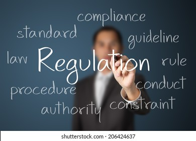 business man writing regulation concept