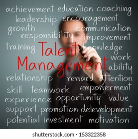 business man writing talent management concept