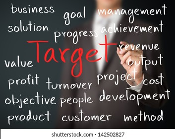 business man writing target concept