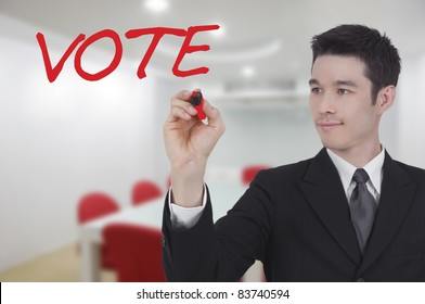 business man writing vote in conference room