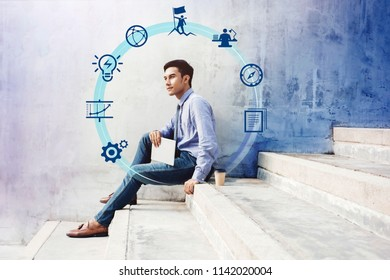 Business Managament Concept. Soft focus of Young Successfull Businessman Working on Tablet at outdoor stair, surrounded by many Icons