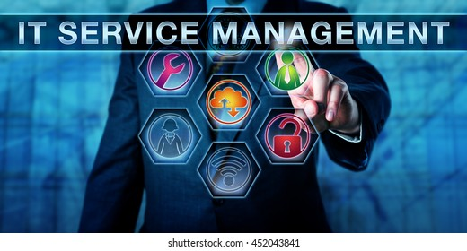 Business manager is touching IT SERVICE MANAGEMENT on a virtual interactive screen. Information technology concept for ITSM and business metaphor. Several tool icons light up in color. Close up shot.