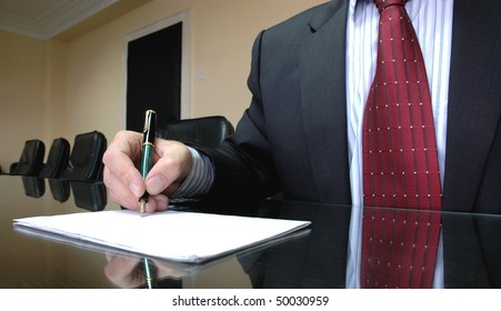 Business Manager writing on blank paper, business concept
