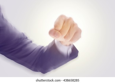 Business man's hand hold fist and punch, isolated on white background, motion radial blur effect, business concept in fight or strength.