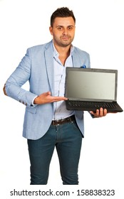 Business mans howing to laptop screen isolated on white background