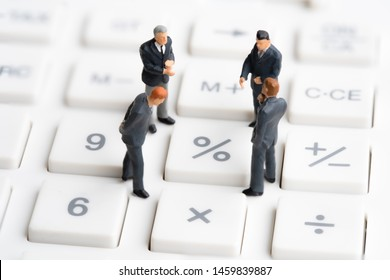 Business mans standing on calculator. Interest rate financial and mortgage rates. Compound interest rate calculation. Risk management financial and managing investment percentage interest rates.