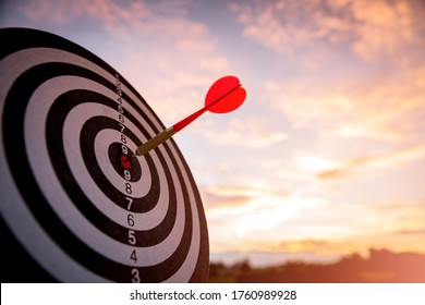 business marketing as concept. Red dart arrow hitting in the target center of dartboard Target hit in the center.
