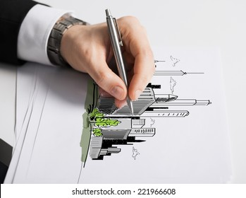 business, marketing, planning and people concept - close up of male hand with pen drawing city on white paper