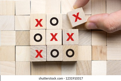 Business or marketing strategy planning concept using wooden cube tic tac toe board game