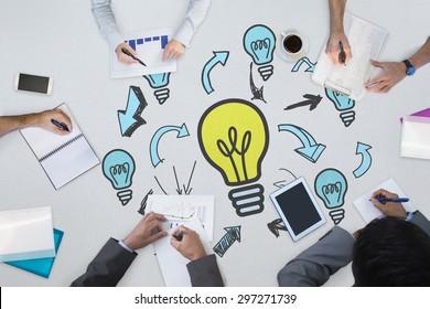 Business meeting against light bulbs