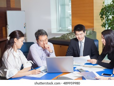 Business meeting, Asian people sitting for a  table with business plan on high floor in the office. Asian nationality a woman  shows a business graph of his business partner.