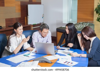 Business meeting, Asian people sitting for table with business plan on high floor in the office. business people negotiate