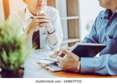 Business meeting asian people two male middle-age discussing while sitting together in modern office.