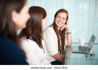 Business meeting between ladies with a laptop on the table.