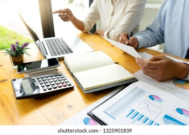Business meeting businessman and colleagues conference professional investor working a new marketing business strategy project discussion and analysis data chart and graph, finance  accounting concept