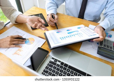 Business meeting businessman and colleagues conference professional investor working a new marketing business strategy project discussion and analysis data chart and graph, finance and accounting