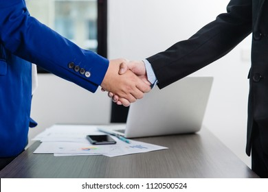 Business meeting concept. Image businessmans handshake. Successful businessmen handshaking after good deal