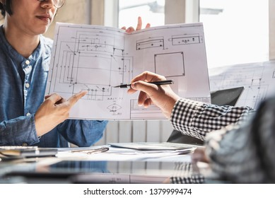 Business meeting construction engineer discussing architect plan.