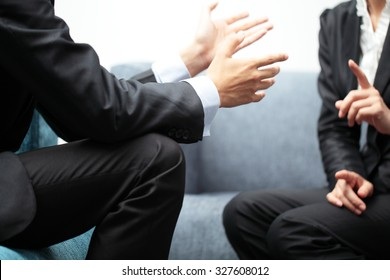 Business Meeting Discussion Between Two People in Suit