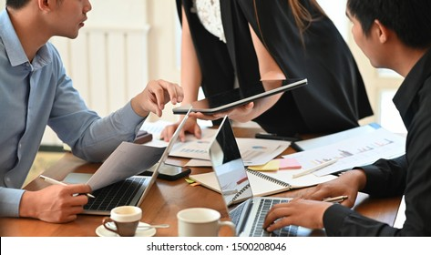 Business meeting group on table.
