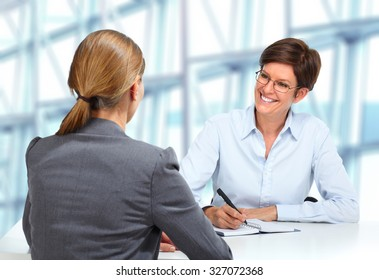 Business meeting. Group of women working with papers.