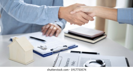 Business meeting Handshake. home loan insurance.Real estate broker and clientsign contract insurance agreement document