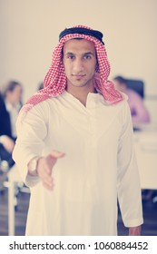 Business meeting - Handsome young Arabic  man presenting his ideas to colleagues and listening for ideas for success investments at bright modern office room