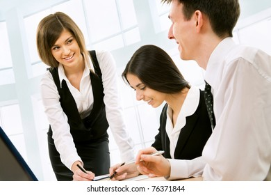 Business meeting - Happy businesspeople talking